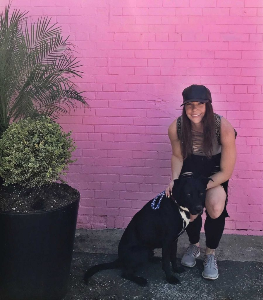 woman and black lab